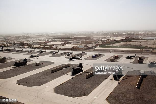 Chinook helicopters sit on Kandahar Airfield The US is effectuating a rolling surge through Kandahar Province the birthplace of the Taliban Photo by...