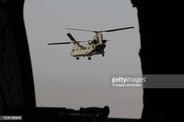 Chinook military helicopter carrying US Defense Secretary Jim Mattis flies towards NATO's Resolute Support mission in Kabul on September 7 2018...