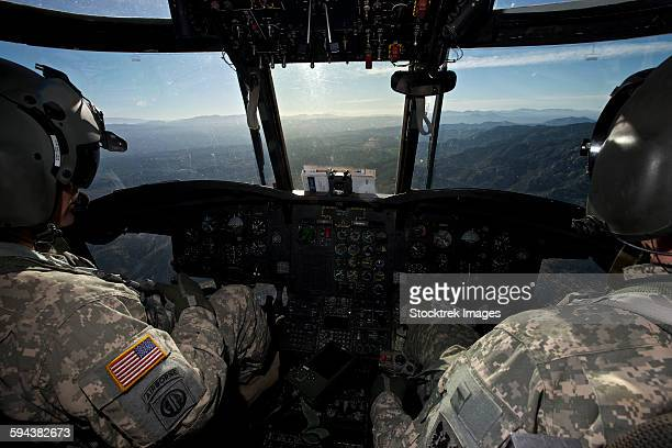 ch-47 chinook pilots in flight over arizona. - inside helicopter stock pictures, royalty-free photos & images