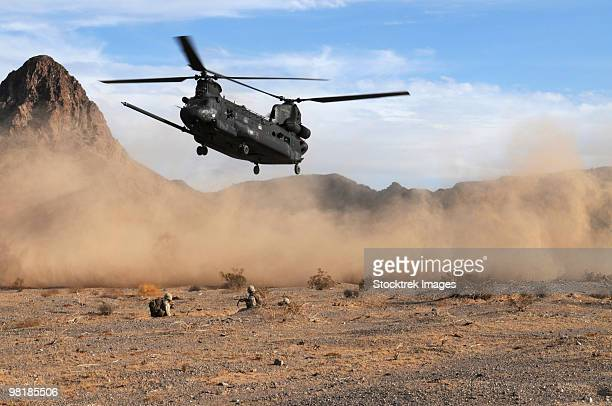 A CH-47 Chinook prepares to land.