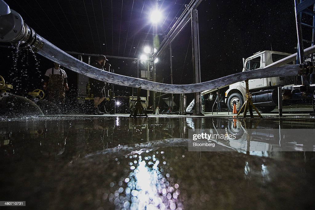 Chinook salmon are pumped into a tanker truck for transport in Anderson, California, U.S., on Tuesday, March 25, 2014. California will begin hauling 30 million young Chinook salmon hundreds of miles toward the Pacific Ocean in tanker trucks to save the fishing industry after a record drought left rivers too low for migration. Photographer: Ken James/Bloomberg via Getty Images