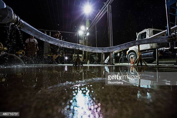 Chinook salmon are pumped into a tanker truck for transport in Anderson California US on Tuesday March 25 2014 California will begin hauling 30...