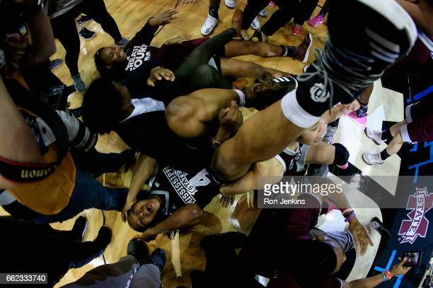 Chinwe Okorie of the Mississippi State Lady Bulldogs lies on the floor as he celebrates their 6664 overtime win against the Connecticut Huskies...