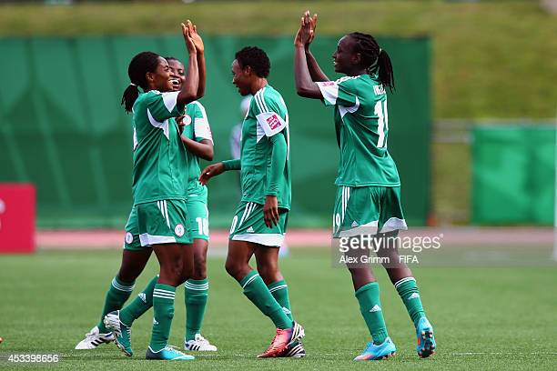 Chinwendu Ihezuo of Nigeria celebrates her team's second goal with team mates during the FIFA U20 Women's World Cup Canada 2014 group C match between...