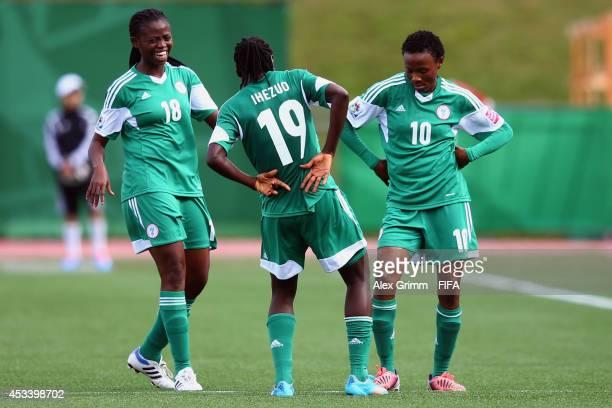 Chinwendu Ihezuo of Nigeria celebrates her team's second goal with team mates Gladys Abasi and Halimatu Ayinde during the FIFA U20 Women's World Cup...