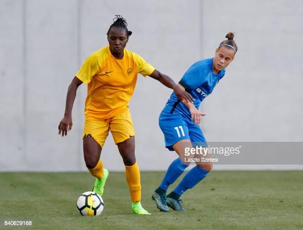 Chinwendu Ihezuo of WFC BIIKKazygurt leaves Dora Papp of MTK Hungaria FC behind during the UEFA Women's Champions League Qualifying match between MTK...