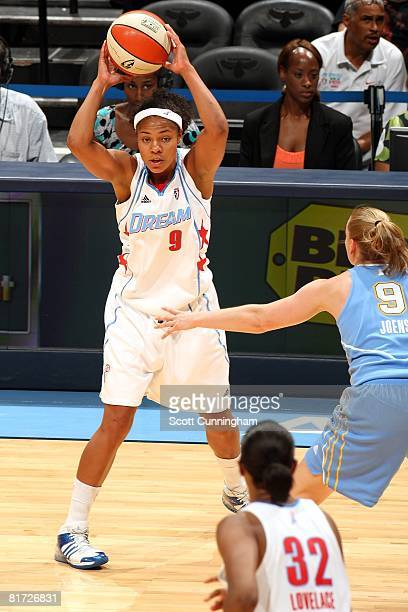 Chioma Nnamaka of the Atlanta Dream looks to pass the ball against Cathy Joens of the Chicago Sky during the WNBA game on June 6 2008 at Philips...