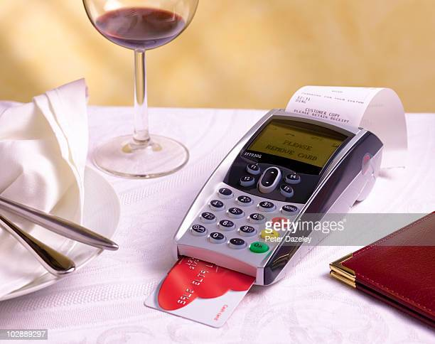 Chip and pin machine on restaurant table