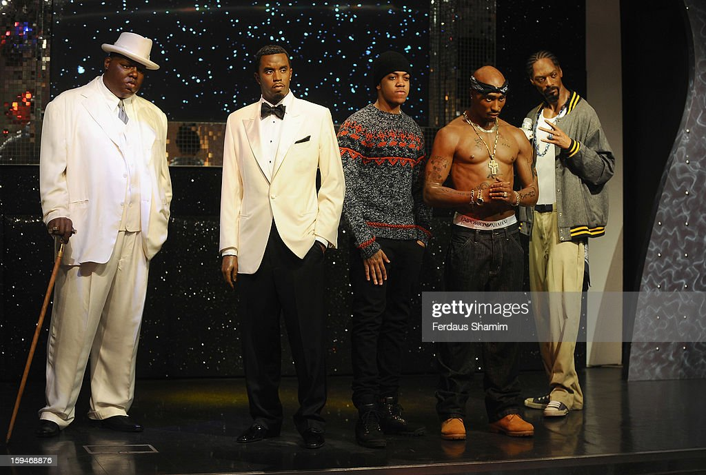 Chip (formerly Chipmunk) (C) attends a photocall to unveil wax figures of rap stars Biggie Smalls (aka The Notorious BIG), P Diddy (2nd L), Tupac Shakur (2nd R) and Snoop Dogg (R), exhibited for the first time together in London at Madame Tussauds on January 14, 2013 in London, England.
