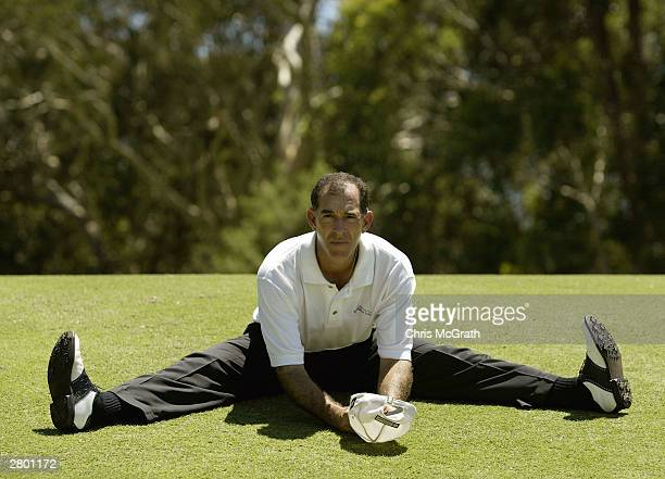 Chip Beck of the USA stretches on the 12th fairway during play on day 1 of the 2003 Australian PGA Championship held December 11, 2003 at the Hyatt...