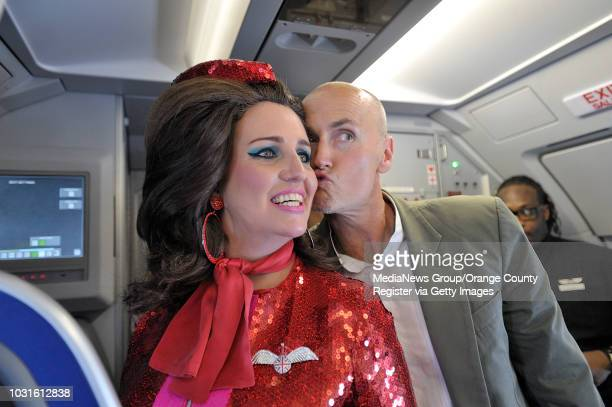 USA Chip Conley Founder of Joie de Vivre Hotels give a kiss to comedian and 'air hostess' Pam Ann during JetBlue's JetPride flight 1969 from San...