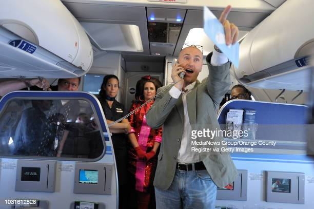 USA Chip Conley Founder of Joie de Vivre Hotels gives out free nights at his hotels as passengers answer questions aboard JetBlue's JetPride flight...