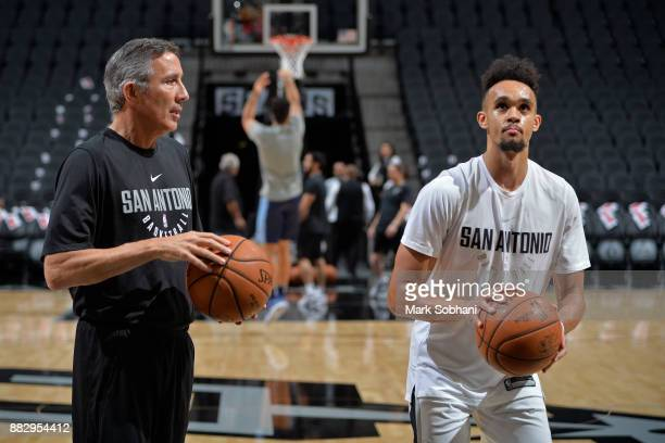 Chip Engelland coaches Derrick White of the San Antonio Spurs before the game against the Memphis Grizzlies on November 29 2017 at the ATT Center in...