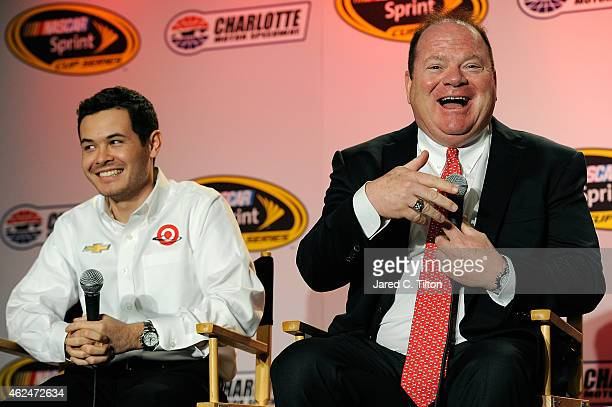 Chip Ganassi , co-owner of Chip Ganassi Racing with Felix Sabates, speaks with the media as Kyle Larson, driver of the Chevrolet, looks on during day...