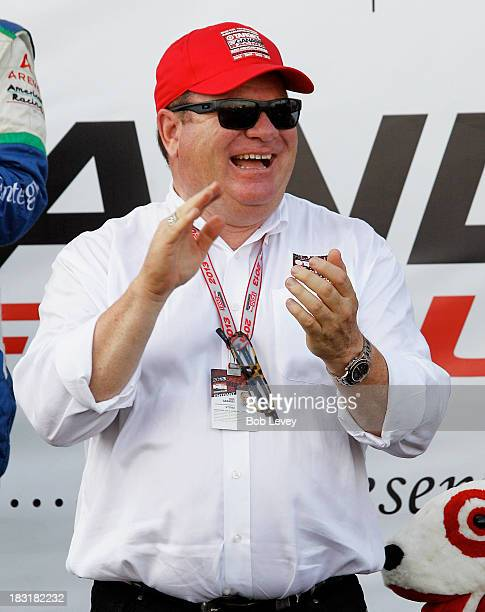 Chip Ganassi of Target Chip Ganassi Racing celebates as he prepares to receive the team first place trophy from AJ Foyt during the first IZOD IndyCar...