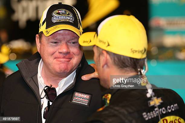 Chip Ganassi owner of Chip Ganassi Racing talks so Jamie McMurray driver of the Bass Pro Chevrolet in victory lane after the NASCAR Sprint Cup Series...