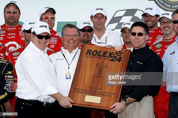 Chip Ganassi owner of the Target Chip Ganassi Racing Lexus Riley is presented the Rolex Manufacturer's Trophy from Gary Reed and Brad Nelson of Lexus...