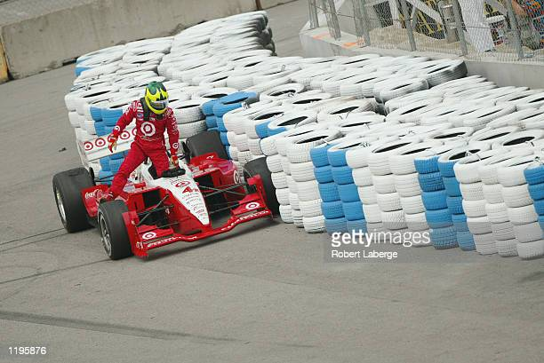 Chip Ganassi Racing driver Bruno Junqueira gets out of his Toyota Lola after crashing into the tire barrier during practice for the Molson Indy...