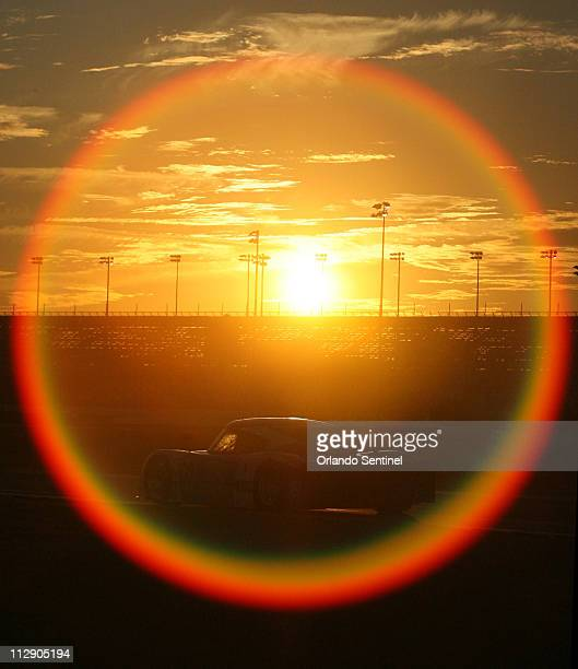 Chip Ganassi's 02 car drives into the sunset during the Rolex 24 Hour auto race at Daytona International Speedway in Daytona Beach, Florida,...