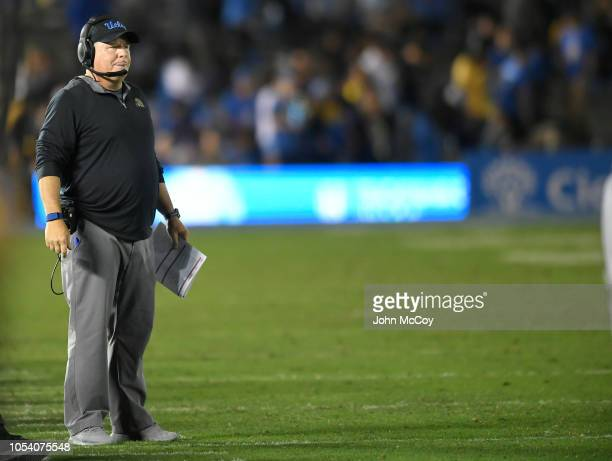 Chip Kelly the head coach of UCLA Bruins stands on the sideline while playing the Utah Utes at the Rose Bowl on October 26, 2018 in Pasadena,...