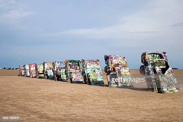 Chip Lord Hudson Marquez and Doug Michels Cadillac Ranch buried Cadillac cars with spray paint on Route 66 in Amarillo Texas Photographed by Carol M...