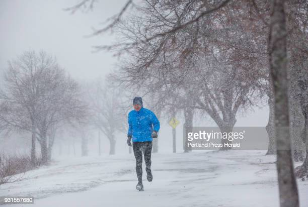 Chip Peters of Portland gets in a run as the snow falls heavily at Back Cove in Portland at 928am on Tuesday March 13 2018