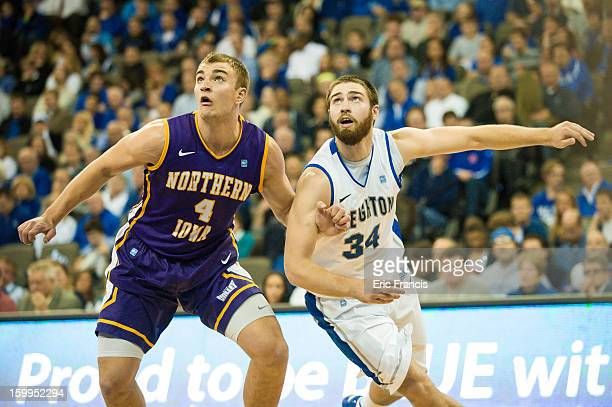 Chip Rank of the Northern Iowa Panthers and Ethan Wragge of the Creighton Bluejays battle for position during their game at the CenturyLink Center on...