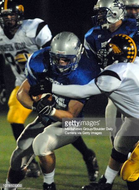 Chip Rollert Broomfield High School tries to break a tackle by Thompson Valley High School during play on Friday at Elizabeth Kennedy Stadium