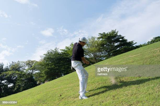 chip up onto the putting green - chip shot stock pictures, royalty-free photos & images