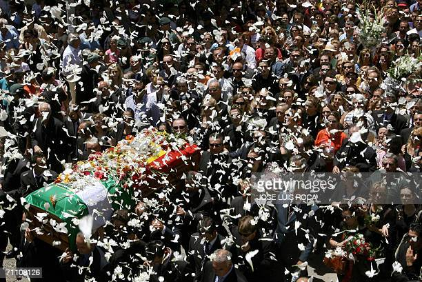 Flower petals rain down on the coffin of singer and actress Rocio Jurado 02 June 2006 during her funeral procession in her home town of Chipiona...