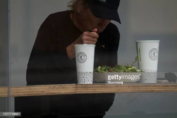 Chipotle Mexican Grill Inc signage is displayed on drink cups at a Chipotle Mexican Grill Inc restaurant in San Francisco California US on Monday...