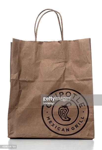 chipotle mexican grill paper bag - chipotle stock pictures, royalty-free photos & images
