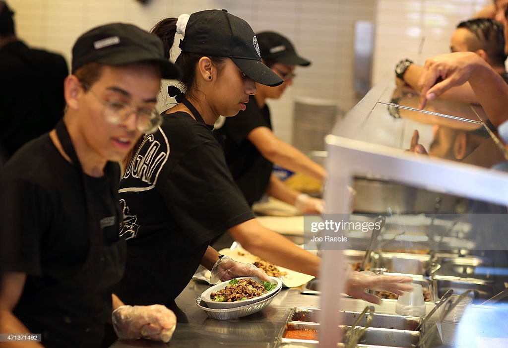Chipotle restaurant workers fill orders for customers on the day that the company announced it will only use non-GMO ingredients in its food on April 27, 2015 in Miami, Florida. The company announced, that the Denver-based chain would not use the GMO's, which is an organism whose genome has been altered via genetic engineering in the food served at Chipotle Mexican Grills.