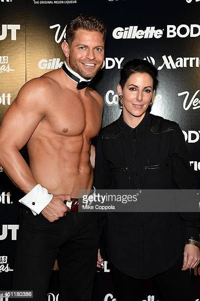 Chippendales' dancer Jaymes Vaughan and DJ Lisa Pitman pose for the 2014 OUT Magazine Hot List NY Pride Party on June 24 2014 in New York City