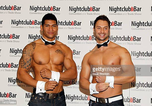 Chippendales dancers James Davis and Nate Estimada arrive at the 27th annual Nightclub Bar Convention and Trade Show at the Las Vegas Convention...