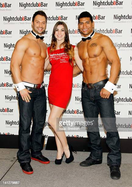 Chippendales dancers James Davis and Nate Estimada arrive with model Carly Richardson at the 27th annual Nightclub Bar Convention and Trade Show at...