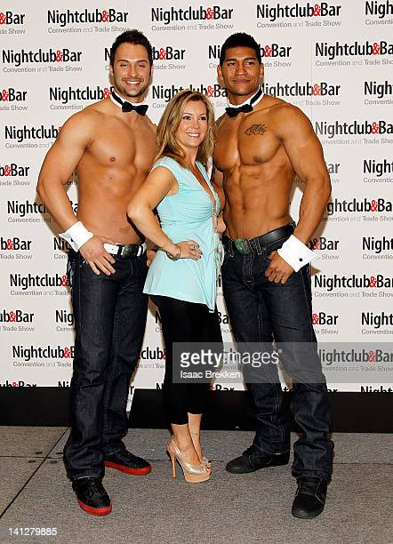 Chippendales dancers James Davis and Nate Estimada arrive with Nicole Taffer at the 27th annual Nightclub Bar Convention and Trade Show at the Las...