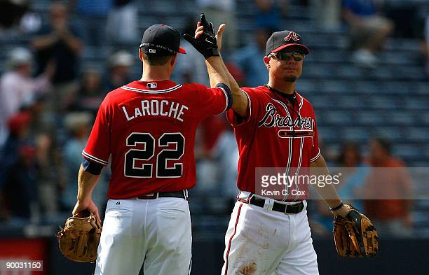 Chipper Jones and Adam LaRoche of the Atlanta Braves celebrate their 75 win over the Florida Marlins on August 23 2009 at Turner Field in Atlanta...