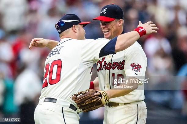 Chipper Jones hugs Eric Hinske of the Atlanta Braves after the game against the New York Mets at Turner Field on September 30 2012 in Atlanta Georgia...