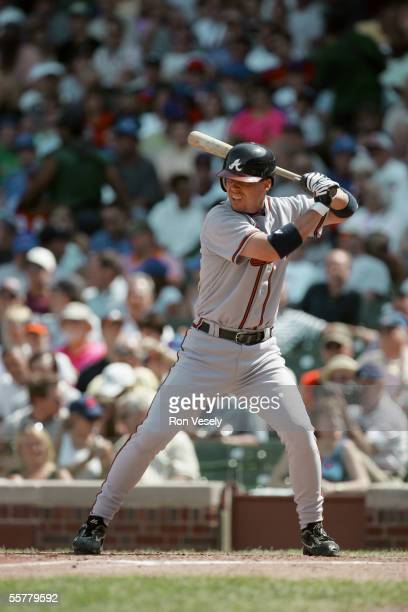 Chipper Jones of the Atlanta Braves bats during the game against the Chicago Cubs at Wrigley Field on August 24 2005 in Chicago Illinois The Braves...