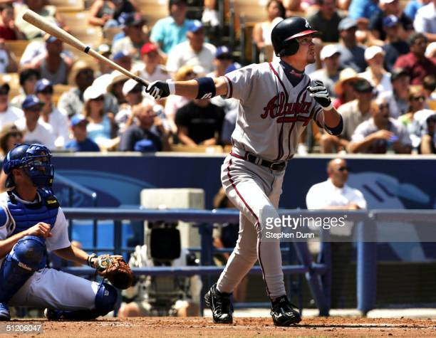 Chipper Jones of the Atlanta Braves hits a three run home run to cap off an eight run second inning against the Los Angeles Dodgers on August 22 2004...