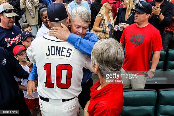 Chipper Jones of the Atlanta Braves hugs his father after the game against the New York Mets at Turner Field on September 30 2012 in Atlanta Georgia...