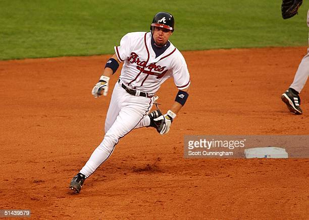 Chipper Jones of the Atlanta Braves rounds second base in game two of the National League Divisional Series against the Houston Astros at Turner...
