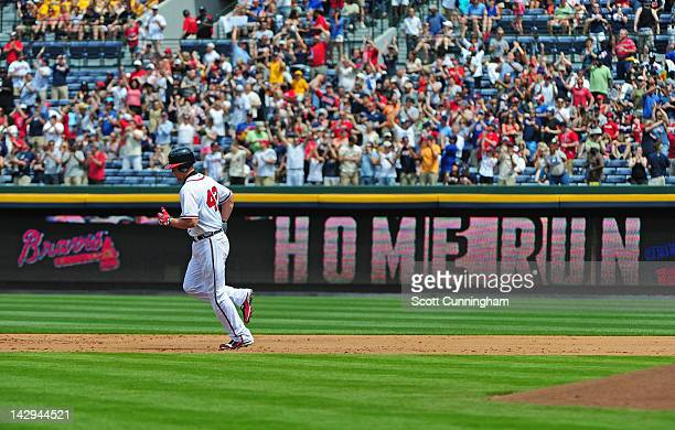 Chipper Jones of the Atlanta Braves rounds the bases after hitting a third inning home run against the Milwaukee Brewers at Turner Field on April 15...