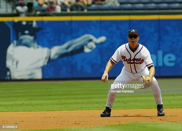 Chipper Jones of the Atlanta Braves stands ready to field the ball during the game against the Kansas City Royals at Turner Field on June 17 2004 in...