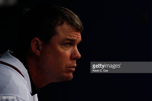 Chipper Jones of the Atlanta Braves waits out a weather delay before the start of the game against the Tampa Bay Rays at Turner Field on June 15 2010...
