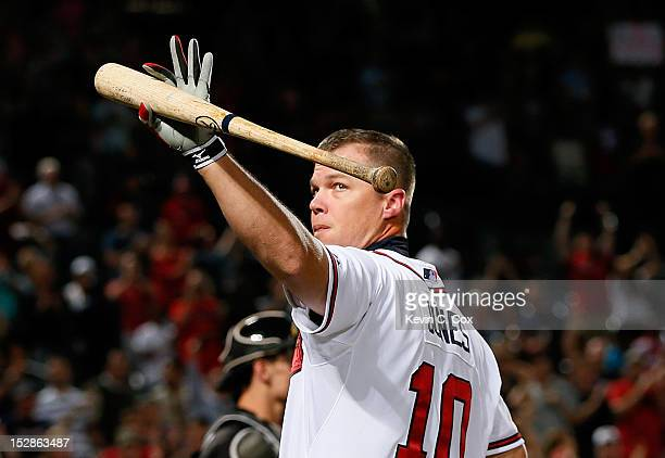 Chipper Jones of the Atlanta Braves waves to the fans during a standing ovation as he stepped to the plate in the second inning against the Miami...