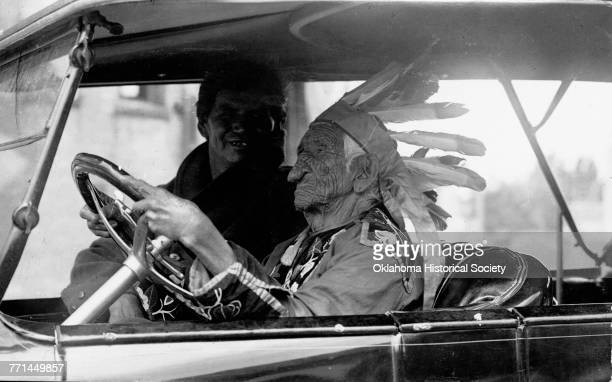 Chippewa Chief KahBeNahGweyWence also known as John Smith driving an automobile Cass Lake Minnesota circa 1920