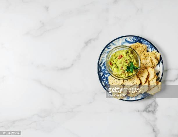 chips and guacamole on white, marble background - guacamole stock pictures, royalty-free photos & images
