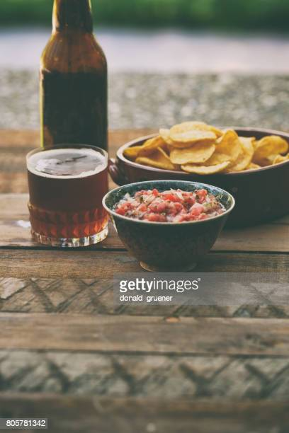 chips and salsa with beer - salsa sauce stock photos and pictures